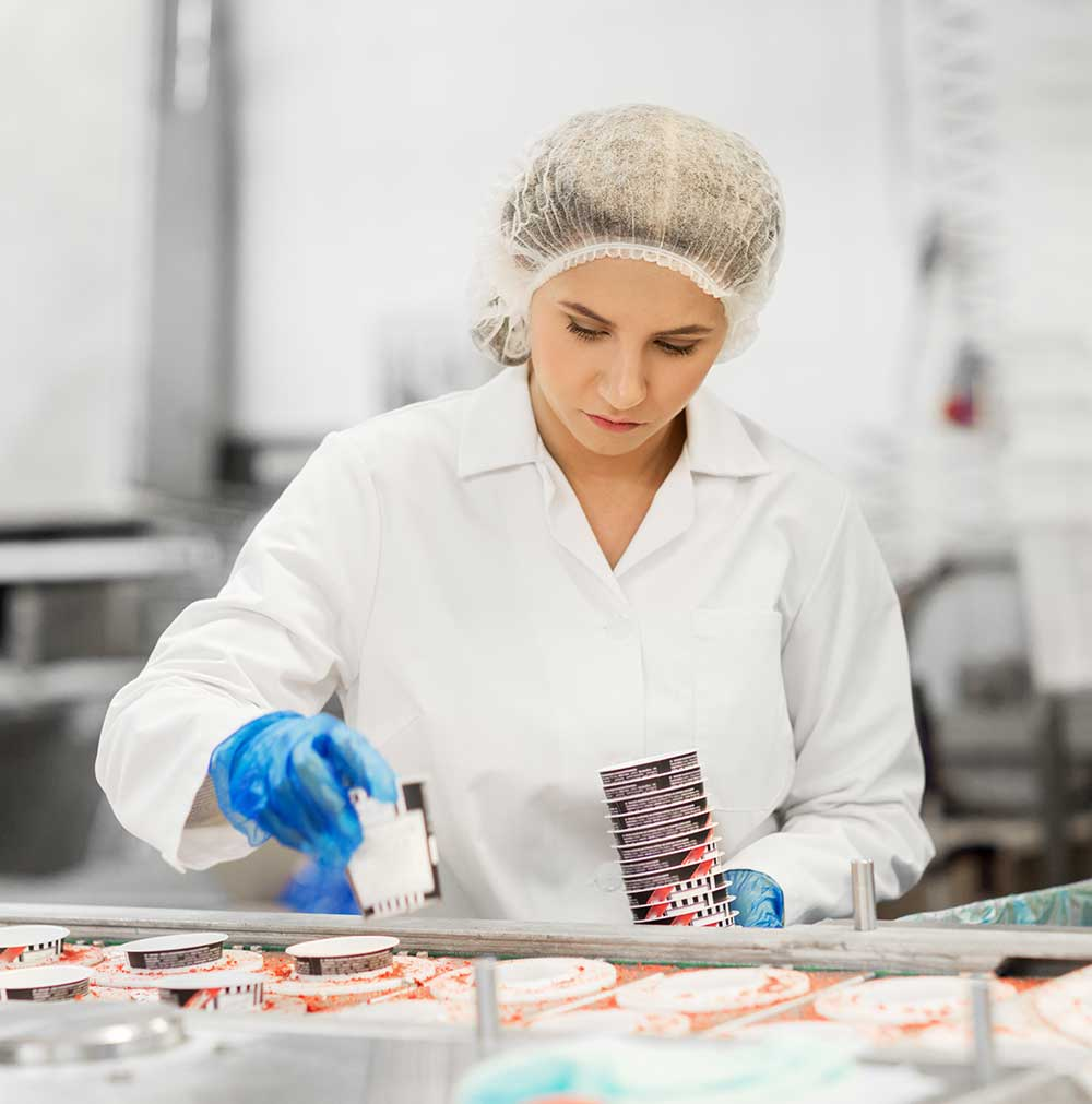 woman-working-at-ice-cream-factory-conve