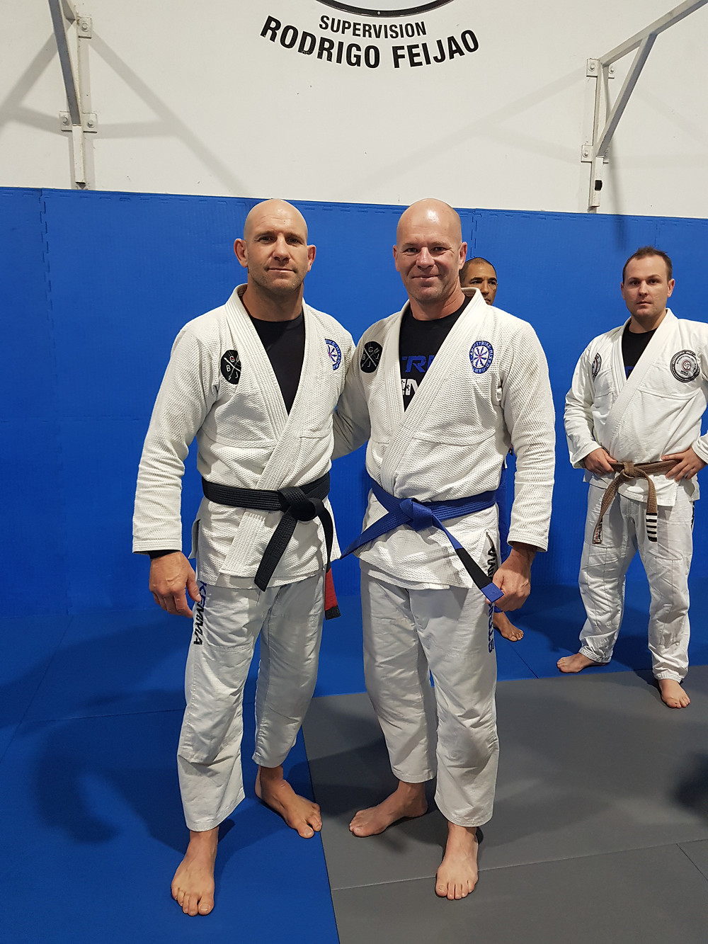 Pete receiving his Blue Belt from coach Dave Johnson