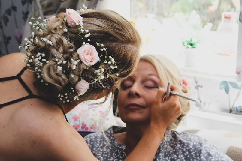 Daughter Emily applying her mothers makeup