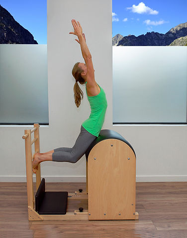 Pilates swan on the ladder barrel