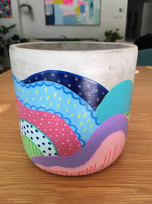 Hand painted concrete pot.