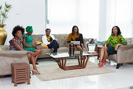 Canva - Group of Women Sitting on Couch.