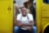 Man on Doorway of Food Truck