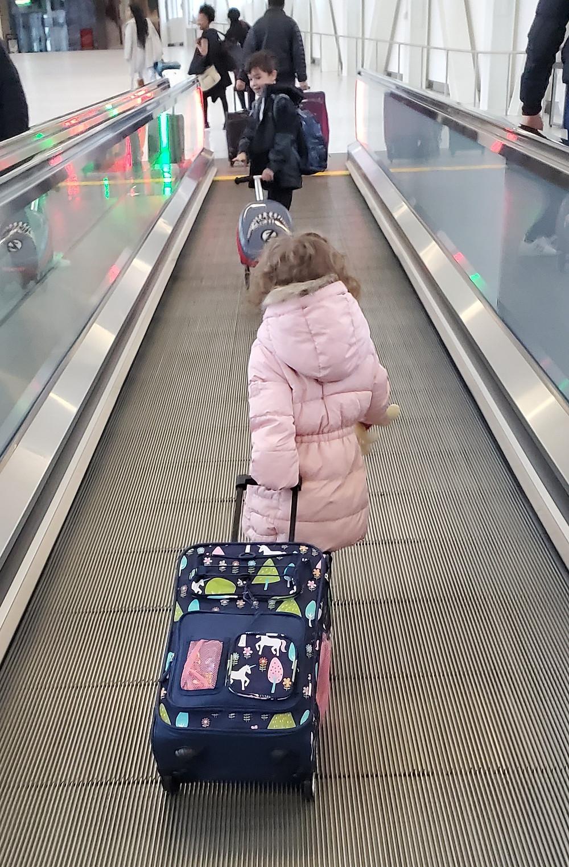 My kids going through JFK Airport.
