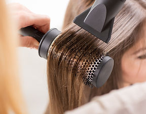 Drying long brown hair with hair dryer a