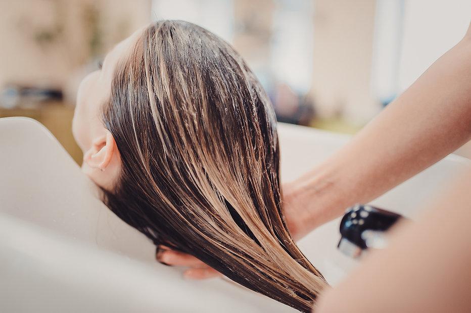 girl in a beauty salon. wash your hair,