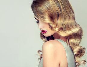 Beautiful girl with long wavy hair .  Bl