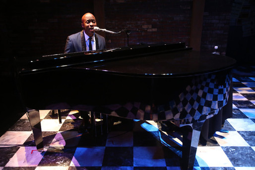 Stephan Terry singing at piano on the set of Billie Holiday Show