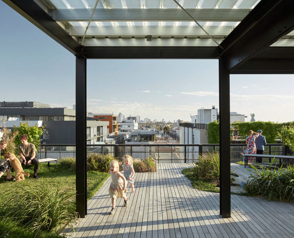 The shared rooftop space at Nightingale 1 features a solar array, productive garden, bee hives, landscaping, outdoor dining area, BBQ, and communal laundry. Nightingale 1 Rooftop, image credit: Tom Ross