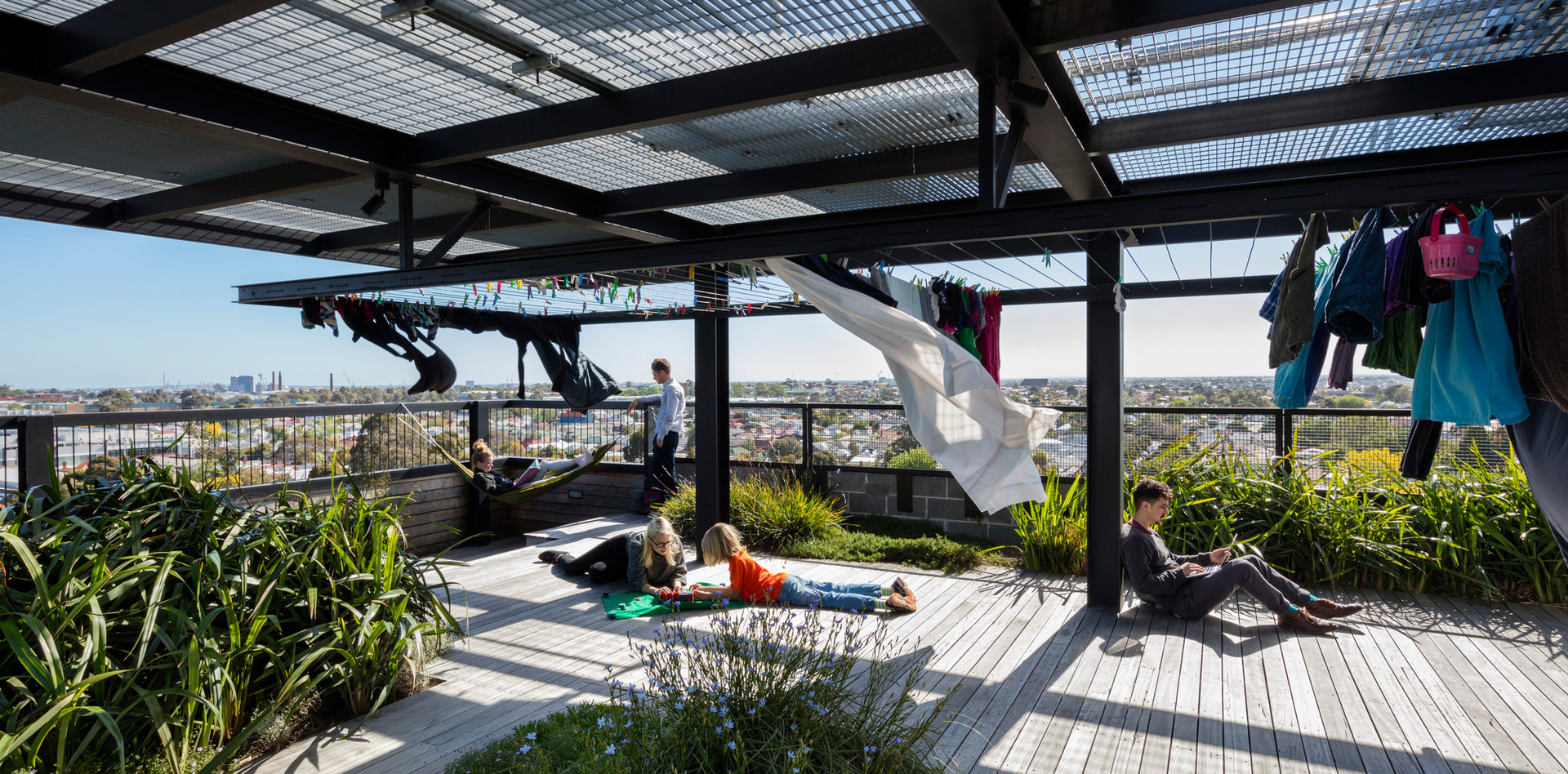The shared rooftop space in The Commons features a solar array, productive garden, landscaping, communal laundry and hanging spaces. The Commons rooftop, image credit: Dianna Snape