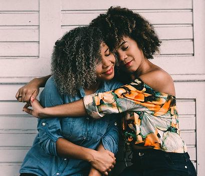 Two women hugging hian-oliveira-614747-u