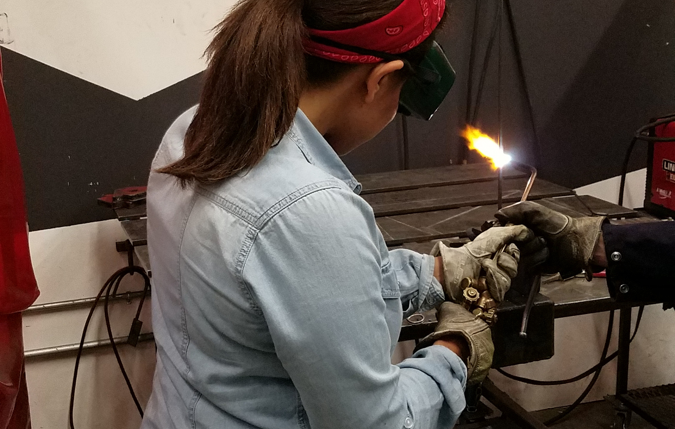 melting metal with a torch