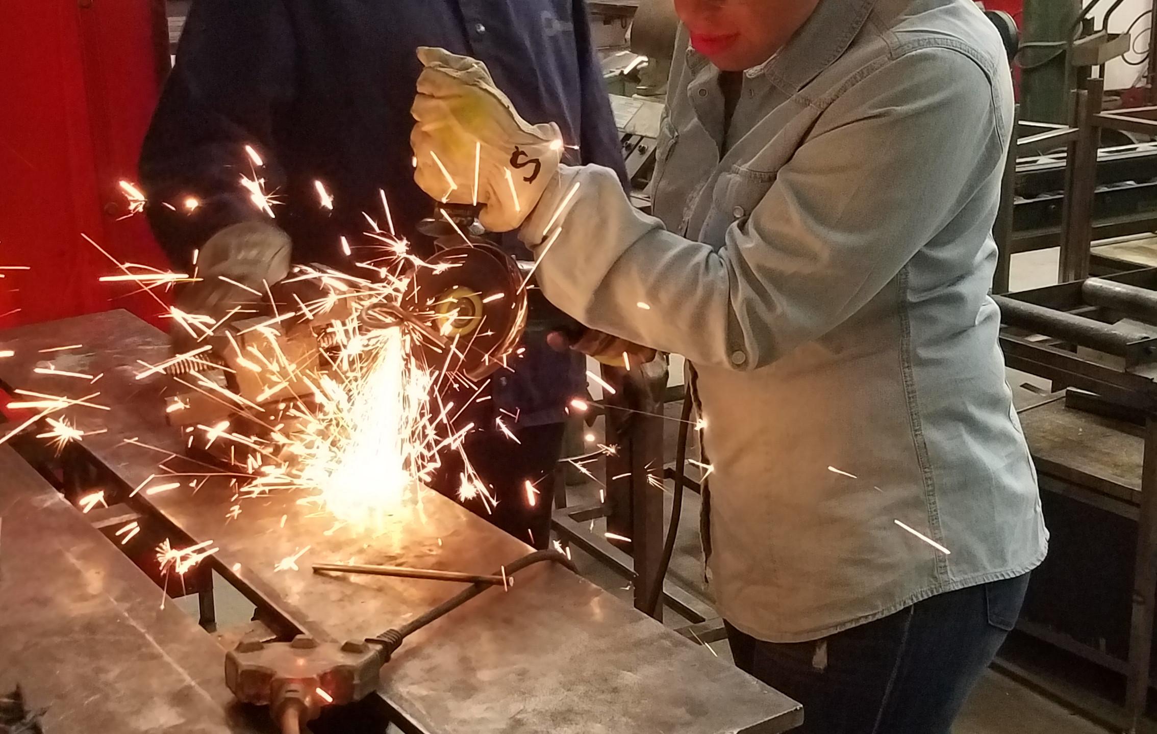 sawing through metal