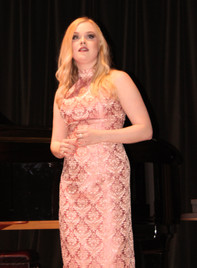 Singer Rebecca DeLacey performs on stage