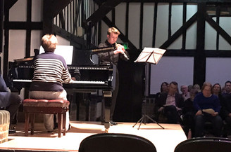 Samuel Jones plays the clarinet on stage