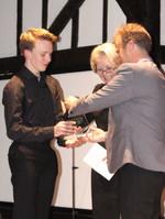 First place winner Samuel Jones holds award