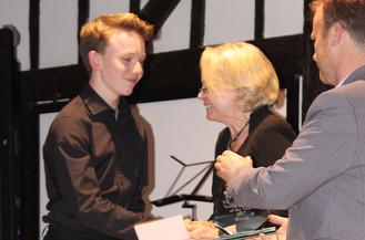 First place, Samuel Jones, receives award
