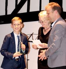 Second place, Lucas Dick, receives award