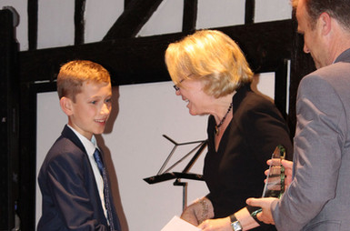 Second place, Lucas Dick, accepts award