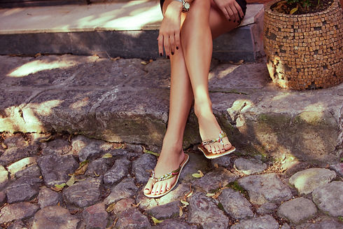 woman legs in  summer flat slippers outdoor day  shot  in city.jpg