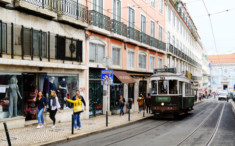 Tram and Shoppers