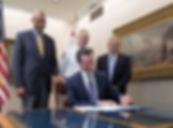 Newsom signing bill.jpg