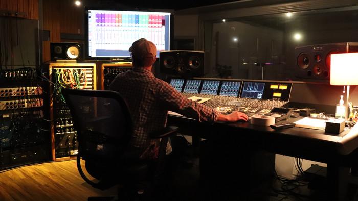 Adam McCoy at the Helm.  Firestation studio in San Marcus