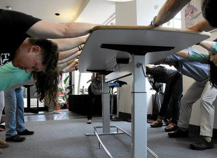 Unfold's Desk + Chair Yoga Class During Focal Upright's Pop-Up Shop Featured in the Chicago