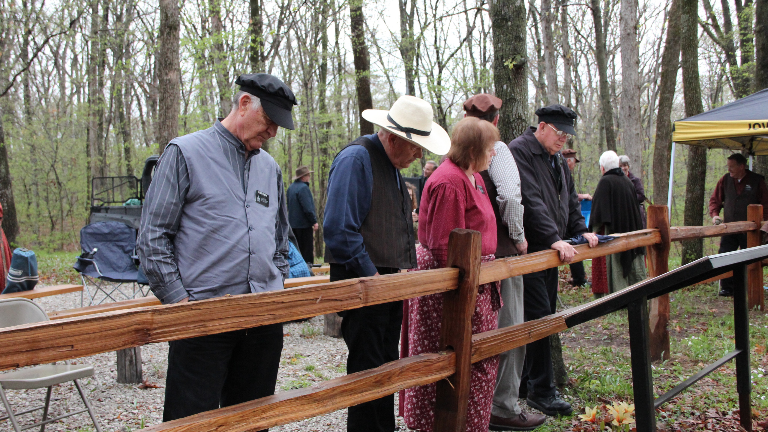 Visitors view graves