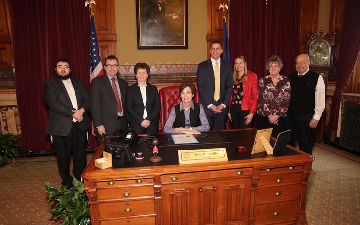 Governor Kim Reynolds signs Proclamation