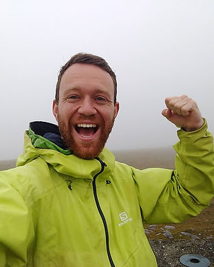 Head shot of James Forrest atop his final Ireland peak bagging summit, Knocknadobar