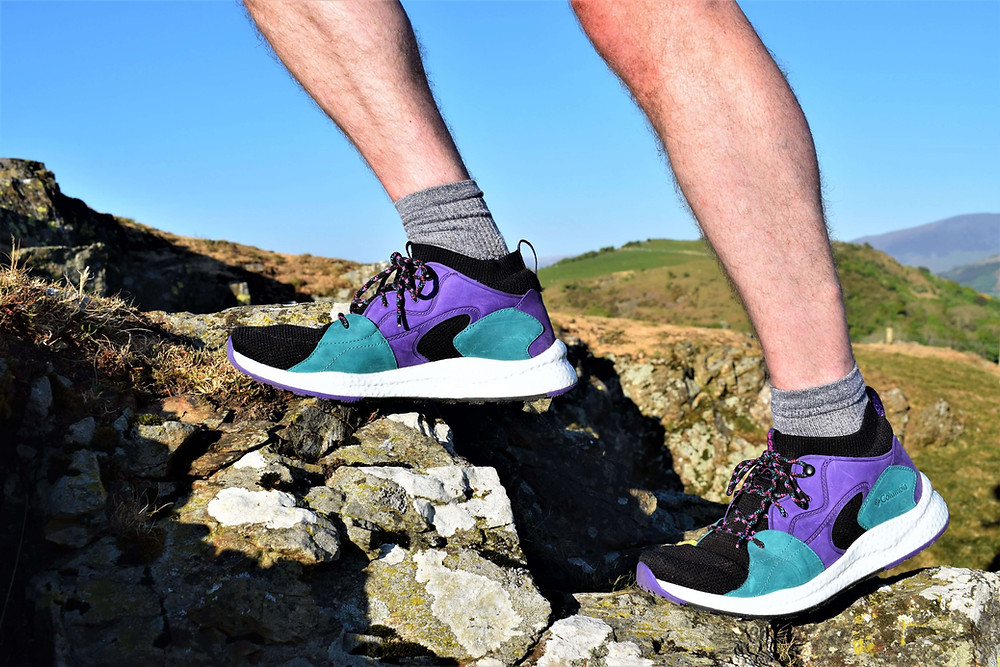 Lower legs of James Forrest wearing Columbia Men's SH/FT OutDry Mid Shoe whilst walking uphill for review