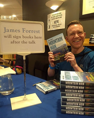 James Forrest preparing to sign his book Mountain Man at an event