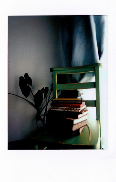 assorted-books-on-green-wooden-chair-349