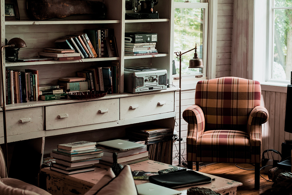Ellipsis Editing professional editing services for academics. Image includes chair, bookcase and books.