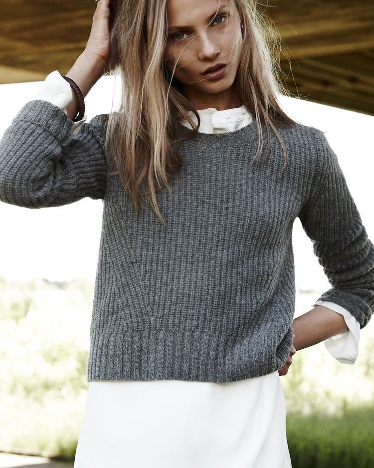 Eliane Porchet grey jumper on white blouse