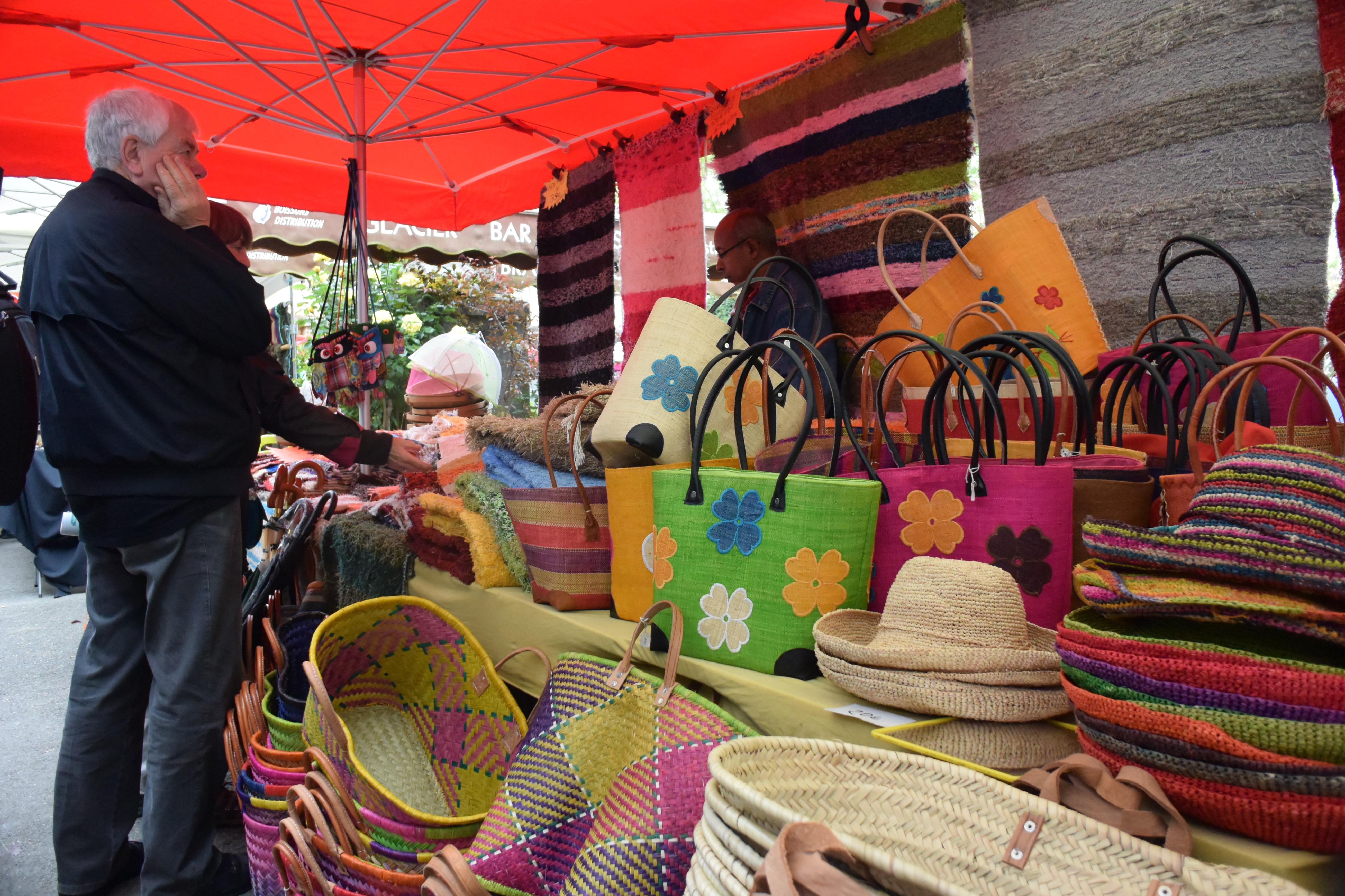 Handbag vendor at market