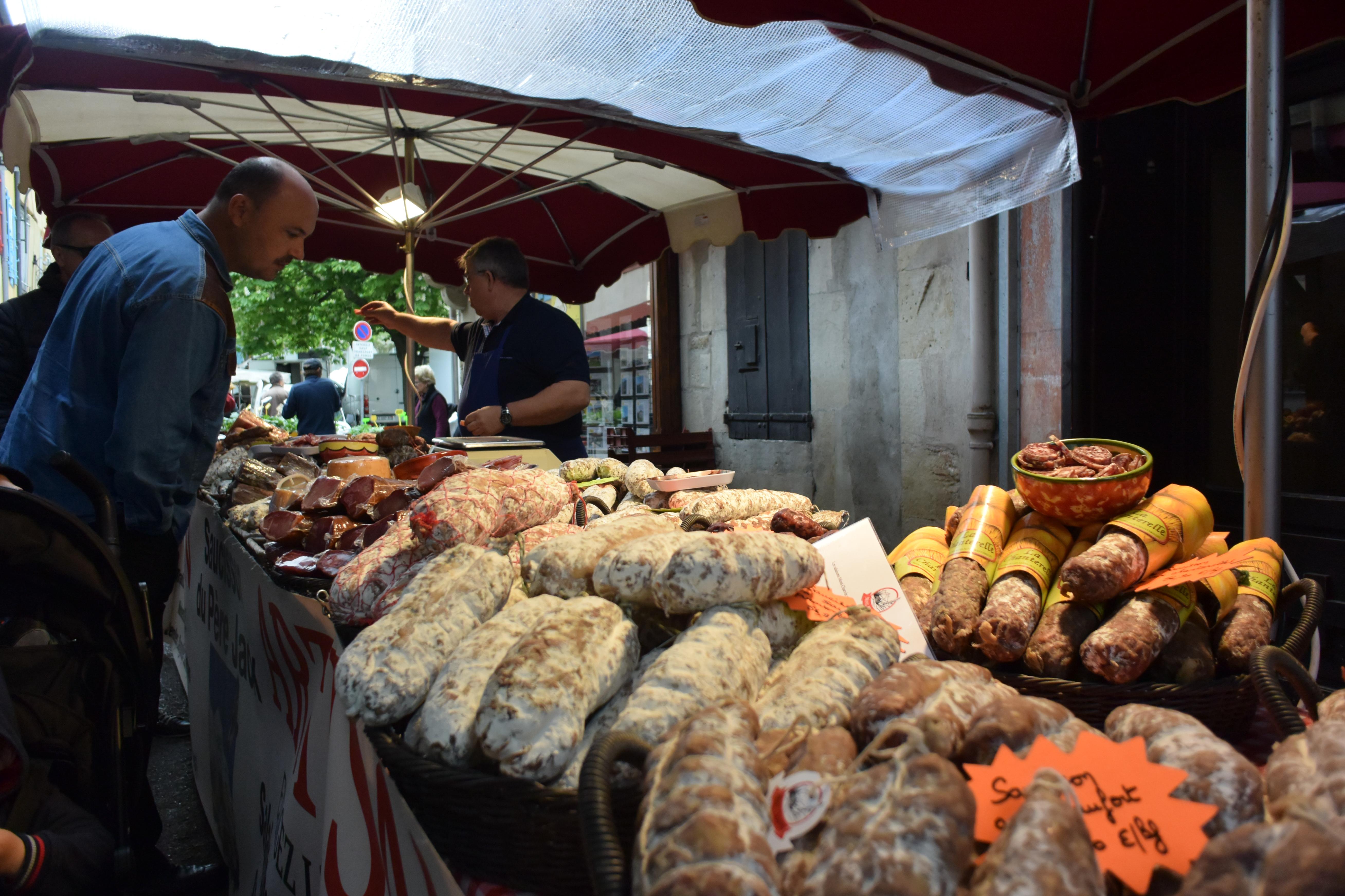 Meat Vendor at Market