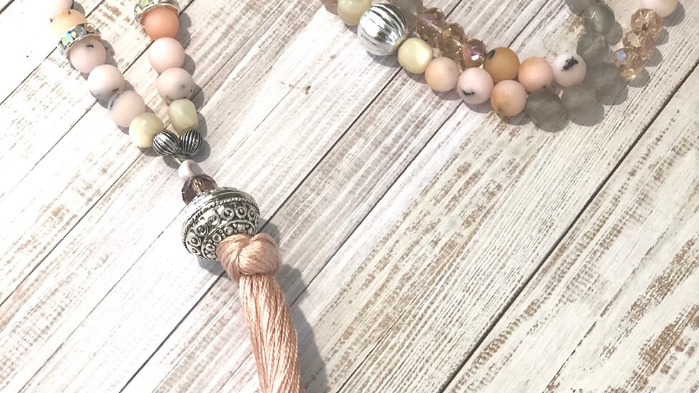 Beautiful long gemstone and bead necklace with tassel .