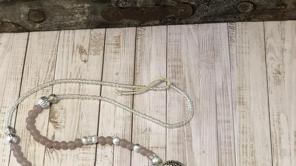 Long dull pink gem tassel necklace