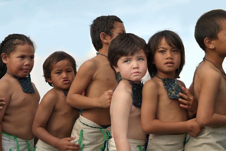 group of young boys doing kapa haka