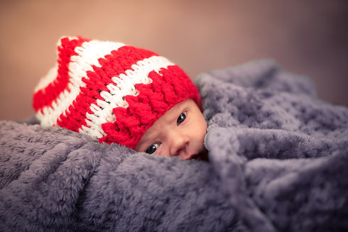 baby wearing a knitted beanie