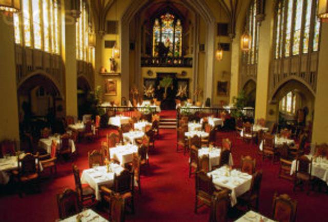 24 Apr 1995, Atlanta, Georgia, USA --- Tables set for dinner at the Abbey Restaurant, a former church. Atlanta, Georgia, USA. --- Image by © Kevin Fleming/Corbis