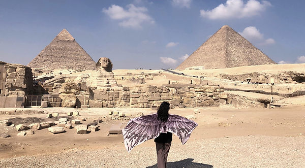 Yasmeen with wings at the Giza Pyramids