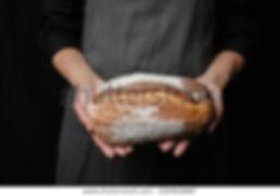 baker-woman-holding-round-fresh-600w-150
