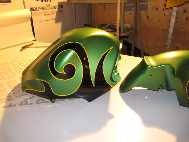 green and black spray paint and yellow vinyl