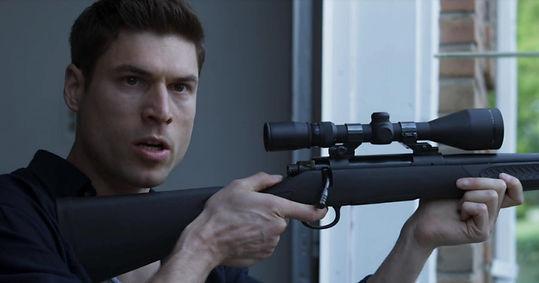 Josh Murray with TC Compass 5.56 rifle.jpg