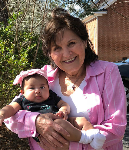 Eva holds a baby she saved from abortion
