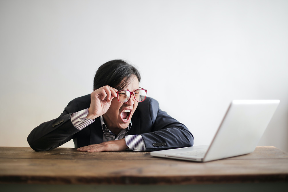 Surprised Man in front of a laptop