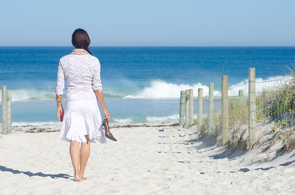 Woman walking beach